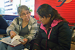Rebecca Ortiz (left) explains the details of bus travel in the U.S. to Paulina Carlo, a refugee from Guatemala, in the Greyhound Bus Station in San Antonio, Texas, on December 1, 2015. Carlo and a daughter came to the U.S. seeking political asylum and were detained upon their arrival by immigration officials. They were released after nine days. Relatives in Tennessee purchased bus tickets for them to travel there while they await a final decision on their asylum petition. Ortiz is a volunteer with the Interfaith Welcome Coalition.