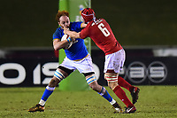 Wales U20's James Botham tackles Italy U20's Antoine Koffi<br /> <br /> Photographer Richard Martin-Roberts/CameraSport<br /> <br /> Six Nations U20 Championship Round 4 - Wales U20s v Italy U20s - Friday 9th March 2018 - Parc Eirias, Colwyn Bay, North Wales<br /> <br /> World Copyright &not;&copy; 2018 CameraSport. All rights reserved. 43 Linden Ave. Countesthorpe. Leicester. England. LE8 5PG - Tel: +44 (0) 116 277 4147 - admin@camerasport.com - www.camerasport.com