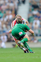 Joe Marler of Harlequins is tackled by David Paice of London Irish during the Premiership Rugby Round 1 match between London Irish and Harlequins at Twickenham Stadium on Saturday 6th September 2014 (Photo by Rob Munro)