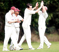 Ed Binns of Highgate is mobbed after making a catch during the Middlesex County League Division Three game between Highgate and Bessborough at Park Road, Crouch End on Sat Sept 4, 2010