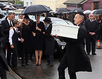 COPY BY TOM BEDFORD<br /> Pictured: Paul Black carries the white coffin of his daughter Pearl to the Jerusalem Baptist Chapel in Merthyr Tydfil, Wales, UK. Friday 18 August 2017<br /> Re: The funeral of a toddler who died after a parked Range Rover's brakes failed and it hit a garden wall which fell on top of her will be held today at Jerusalem Baptist Chapel in Merthyr Tydfil.<br /> One year old Pearl Melody Black and her eight-month-old brother were taken to hospital after the incident in south Wales.<br /> Pearl's family, father Paul who is The Voice contestant and mum Gemma have said she was &quot;as bright as the stars&quot;.