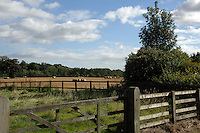 Five barred gate at entrance to cornfield. North Yorkshire, England. Sep 2007.