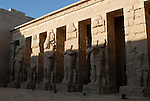 "Statues of Rameses III as the god Osiris on the North side of the First Court at the mortuary temple of Ramses III at Medinet Habu, at Thebes.Thebes was the ancient capital of Egypt and was built in and around modern day Luxor.The ancient name for Medinet Habu was Djamet meaning ""males and mothers."" Its holy ground was believed to be where the Ogdoad,the four pairs of primeval gods,were buried.Medinet Habu was both a temple and a complex of temples.Queen Hatshepsut who ruled Egypt from 1479-1458 BC  and Tuthmosis III who reigned from 1479-1425 BC built a small temple to Amun on the site of an earlier structure. Next to their temple, Ramses III who reigned from 1186-1155 BC built his mortuary temple.He then enclosed both structures within a massive mud-brick enclosure.The temple precinct measures about 700 feet by 1000 feet and contains more than 75,350 sq ft of decorated surfaces across its walls.It is the best preserved of all the mortuary temples of Thebes."