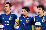 Yoshida Maya (L), Shibasaki Gaku (C) and Endo Wataru of Japan (R) listen to their national anthem prior to the AFC Asian Cup UAE 2019 Group F match between Oman (OMA) and Japan (JPN) at Zayed Sports City Stadium on 13 January 2019 in Abu Dhabi, United Arab Emirates. Photo by Marcio Rodrigo Machado / Power Sport Images