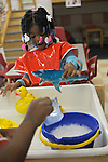 Alena Yerger, 3, plays in Room 113 at the Educare Early Childhood Center in Chicago on November 21, 2008.  The pre-K daycare center is a model for head start, funded privately by the Gates and other foundations, that cares for and educates infants, toddlers, and 3- and 4-year old pre-school children.