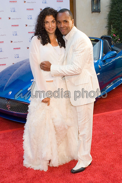 """9 July 2005 - Pacific Palisades, California - Sugar Ray Leonard and wife.  Hollyrod's Designcure Celebrates It's 'Lucky Seven' with Performances by Kenneth """"Babyface""""  Edmonds & Brian Culbertson and Featuring Fashion Show with Designer Pamela Dennis held at the home of Sugar Ray Leonard.  Photo Credit: Zach Lipp/AdMedia"""