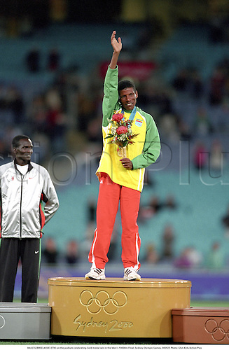 HAILE GEBRSELASSIE (ETH) on the podium celebrating Gold medal win in the Men's 10000m Final, Sydney Olympic Games, 000925 Photo: Glyn Kirk/Action Plus...2000 athletics athlete distance runner olympics.podiums podium rostrum rostrums celebrate celebrates celebrating celebration joy