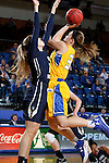 BROOKINGS, SD - DECEMBER 11:  Sydney Palmer #32 from South Dakota State University takes the ball to the basket against Lexi Martins #24 from George Washington during their game Sunday afternoon at Frost Arena in Brookings. (Photo by Dave Eggen/Inertia)