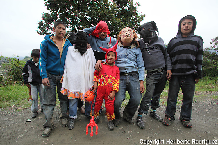Native nahuatl children with face masks beg for money outside their village in San Francisco Atotnilco in northern state of Hidalgo, during the festivities of the Day of the Deads. Hundreds of Native villages pay homage to their deads on the eve of November 2 as a tradition since the preHispanic times. Photo by Heriberto Rodriguez