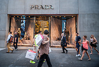 The Prada store on Fifth Avenue in New York is seen on Tuesday, June 16, 2015. Luxury goods makers such as Prada, Louis Vuitton and Gucci are seeing a shift in buying habits from conspicuous high-end fashion to more unique, logo-less and bespoke purchases. (© Richard B. Levine)