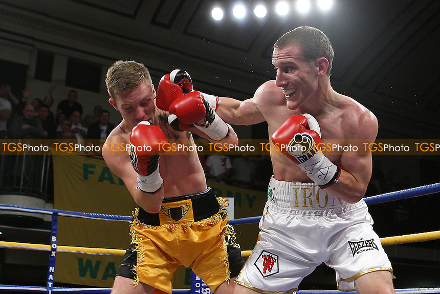 Ryan Walsh (white shorts) defeats Liam Richards to win the English Super-Bantamweight Title at York Hall, Bethnal Green, promoted by Frank Warren - 21/10/11 - MANDATORY CREDIT: Gavin Ellis/TGSPHOTO - Self billing applies where appropriate - 0845 094 6026 - contact@tgsphoto.co.uk - NO UNPAID USE