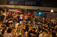 Pro-democracy protesters are seen blocking the busy intersection of Nathan Road and Argyle Street on the first day of Occupy Hong Kong, Mong Kok, Kowloon, Hong Kong, China, 29 September 2014. Several areas of the city including Central, Admiralty, Causeway Bay, as well as Mong Kok in Kowloon, were locked down by Occupy Central civil disobedience teams who fanned out across the city blocking major thoroughfares as well as side streets, with rip ties, metal barriers, police road cones and any other street furniture available to hand.