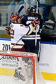 Ryan Donald (Yale - 25) accidentally joins Ben Smith (BC - 12) and Joe Whitney's (BC - 15) celebration. - The Boston College Eagles defeated the Yale University Bulldogs 9-7 in the Northeast Regional final on Sunday, March 28, 2010, at the DCU Center in Worcester, Massachusetts.
