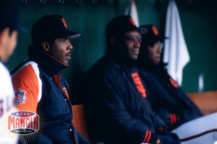 SAN FRANCISCO, CA - Barry Bonds of the San Francisco Giants sits in the dugout next to his father Bobby Bonds during a game at Candlestick Park in San Francisco, California in 1994. Photo by Brad Mangin