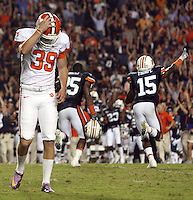 Clemson place kicker Chandler Catanzaro reacts to missing a field goal to tie the game in overtime Saturday against Auburn. An earlier made field goal was called back on a penalty and the resulting kick gave Auburn the 27-24 win. asdfg Defeated
