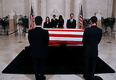 United States President Barack Obama and First Lady Michelle Obama pay their respects to US Supreme Court Justice Anthony Scalia, in front of the casket bearing his body, in the Great Hall of the US Supreme Court, Washington, DC, February 17, 2016.  Anthony Scalia died February 13, 2016, at age 79, during a hunting trip in West Texas. <br /> Credit: Aude Guerrucci / Pool via CNP