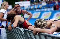 12 JUL 2009 - KITZBUHEL, AUT - Vendula Frintova (right) and Kathy Tremblay recover after finishing - ITU World Championship Series Womens Triathlon (PHOTO (C) NIGEL FARROW)