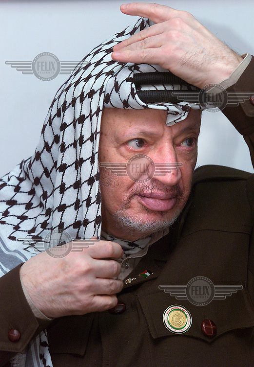 Palestinian president Yassir Arafat in his Ramallah headquarters.