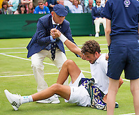 London, England, 30 june, 2016, Tennis, Wimbledon, Robin Haase (NED) falls to the grass in his match against Jack Sock (USA) and is helped up by the chair umpire<br /> Photo: Henk Koster/tennisimages.com