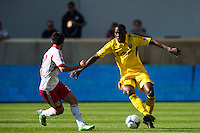 Tony Tchani (6) of the Columbus Crew is marked by Kosuke Kimura (27) of the New York Red Bulls. The New York Red Bulls and the Columbus Crew played to a 2-2 tie during a Major League Soccer (MLS) match at Red Bull Arena in Harrison, NJ, on May 26, 2013.