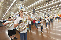 NWA Democrat-Gazette/FLIP PUTTHOFF <br />STRIKE UP THE BAND<br />Ethan Andrews (second from left) performs Tuesday April 10 2018 with the Bentonville Pride Marching Band at the Walmart store at the Pleasant Crossing shopping center in Rogers. The high schoool band was on hand to celebrate the national release of the movie, &quot;The Greatest Showman,&quot; said Alisha Pettigrew, a Bentonville band parent. Students performed the song, &quot;This Is Me,&quot; from the movie. Their performance was filmed as part of a marketing promotion for the movie, store personnel said. Students performed from 5 a.m. to 7 a.m. so shopper traffic wouldn't be impeded, Pettigrew said. Band members are used to early hours from traveling to band competitions, she added.