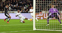 Andre Ayew of Swansea (2nd L) has his shot saved by Kasper Schmeichel of Leicester City (R) during the Barclays Premier League match between Swansea City and Leicester City at the Liberty Stadium, Swansea on December 05 2015