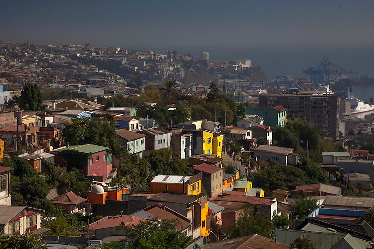 Colorful wooden houses cling to the slopes above the port port town of Valparaiso on the Chilean coast