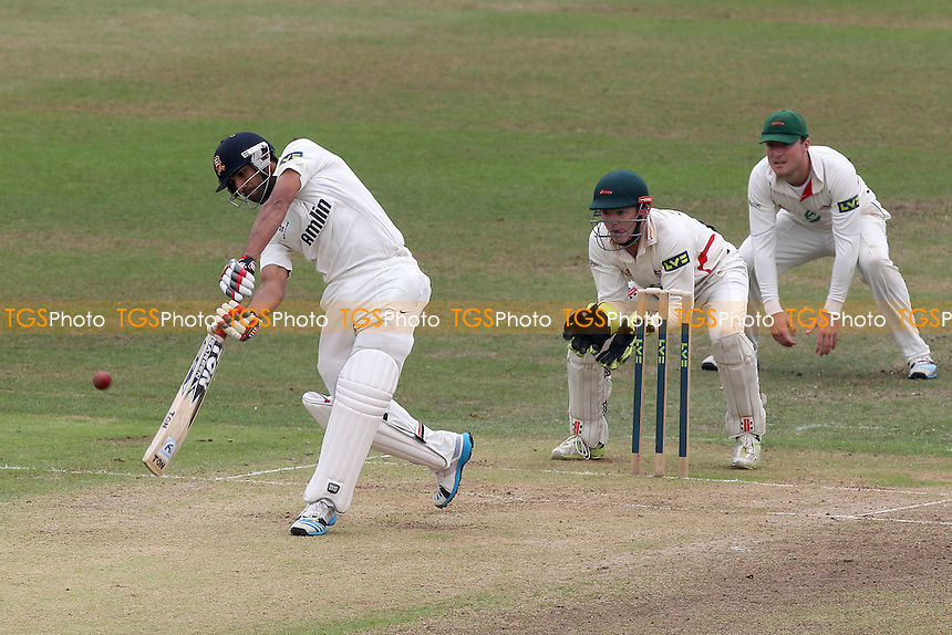 Ravi Bopara hits four runs for Essex as Niall O'Brien looks on - Leicestershire CCC vs Essex CCC - LV County Championship Division Two Cricket at Grace Road, Leicester - 16/09/14 - MANDATORY CREDIT: Gavin Ellis/TGSPHOTO - Self billing applies where appropriate - contact@tgsphoto.co.uk - NO UNPAID USE