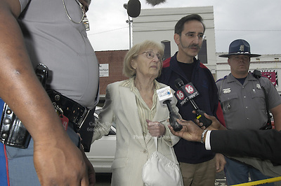 Mrs. Goodman is escorted from the courthouse in Neshoba County during the Edgar Ray Killen trial, , over 40 years after her son was murdered during the summer of 1964. Photo©Suzi Altman