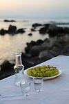 Raki with grapes at Restaurant Thalassino Ageri in Chania, Crete, Greece, Europe