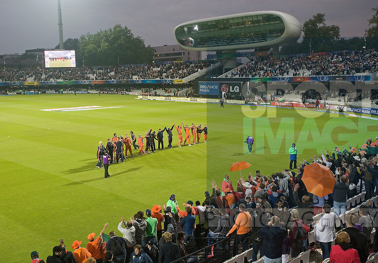 The Dutch players celebrate with their supports after gaining victory over England at Lord's.