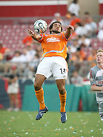 Houston Dynamo midfielder Dwayne De Rosario (14) attempts to control the ball. Houston Dynamo defeated FC Dallas 1-0 in an MLS regular season match at Robertson Stadium in Houston, TX on August 19, 2007.