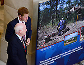 Escorted by United States Senator John McCain (Republican of Arizona) Prince Harry visits an exhibition in the Russell Senate Office Building on Capitol Hill in Washington, D.C. staged by the HALO Trust on Thursday, May 9, 2013.  The HALO Trust's purpose is to remove land mines and other debris left behind by war that might present a danger to civilians..Credit: Ron Sachs / CNP