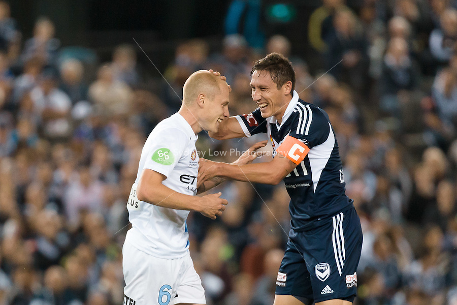 MELBOURNE 25 Oct 2014 – Aaron MOOY of Melbourne City and Mark MILLIGAN of the Victory share a joke in the round 3 match between Melbourne Victory and Melbourne City in the Australian Hyundai A-League 2014-15 season at Etihad Stadium, Melbourne, Australia.
