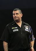 29.12.2015. Alexandra Palace, London, England. William Hill PDC World Darts Championship. World Champion Gary Anderson prepares to throw the first dart