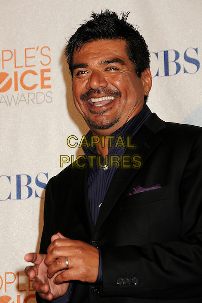 GEORGE LOPEZ.Pressroom at the 36th Annual People's Choice Awards held at the Nokia Theatre LA Live, Los Angeles, California, USA..January 6th, 2009.press room half length black blue goatee facial hair suit jacket hands smiling mouth open.CAP/ADM/BP.©Byron Purvis/AdMedia/Capital Pictures.