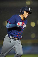 Lehigh Valley IronPigs shortstop J.P. Crawford (3) runs the bases in the rain after hitting a home run during a game against the Buffalo Bisons on July 9, 2016 at Coca-Cola Field in Buffalo, New York.  Lehigh Valley defeated Buffalo 9-1 in a rain shortened game.  (Mike Janes/Four Seam Images)