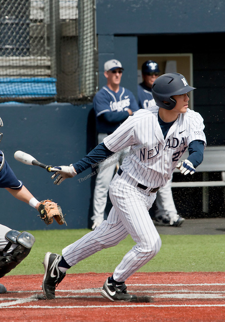 March 30, 2012:   Nevada Wolf Pack's Kewby Meyer slaps a single against the BYU Cougars during their NCAA baseball game played at Peccole Park on Friday afternoon in Reno, Nevada.