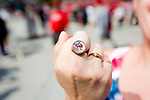 A Washington Nationals fan shows off her vintage ring prior to a game against the Miami Marlins at Nationals Park in Washington, DC on September 8, 2012.