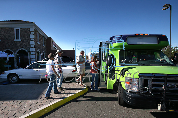The JAC bus makes a pickup at the Carson Mall during the 20th annual Taste of Downtown event in Carson City, Nev., on Saturday, June 15, 2013. The event features 44 local restaurants in a fundraiser for the Advocates to End Domestic Violence.<br /> Photo by Cathleen Allison