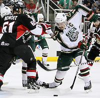 Houston Aeros' Jon DiSalvatore, right, battles Binghamton Senators' Andre Benoit for the puck during the first period of game six of the AHL Calder Cup Finals, Tuesday, June 7, 2011, in Houston. (Darren Abate/pressphotointl.com/AHL)