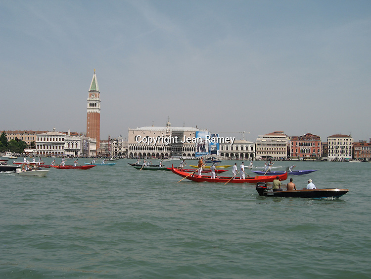 A traditional regatta of gondolas passes Venice's famous landmarks.