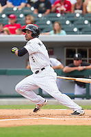 Micah Johnson (3) of the Charlotte Knights follows through on his swing against the Pawtucket Red Sox at BB&T Ballpark on August 8, 2014 in Charlotte, North Carolina.  The Red Sox defeated the Knights  11-8.  (Brian Westerholt/Four Seam Images)