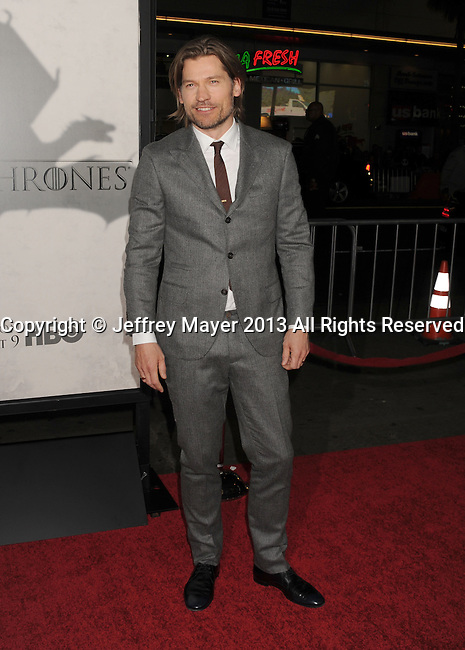 """HOLLYWOOD, CA - MARCH 18: Nikolaj Coster-Waldau arrives at the Los Angeles premiere of HBO's """"Game Of Thrones"""" Season 3 at TCL Chinese Theater on March 18, 2013 in Hollywood, California."""