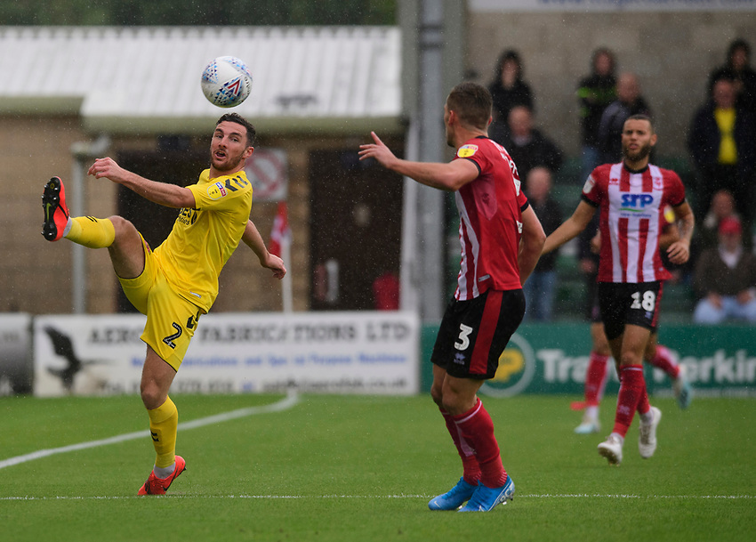 Fleetwood Town's Lewis Coyle vies for possession with Lincoln City's Harry Toffolo<br /> <br /> Photographer Chris Vaughan/CameraSport<br /> <br /> The EFL Sky Bet League One - Lincoln City v Fleetwood Town - Saturday 31st August 2019 - Sincil Bank - Lincoln<br /> <br /> World Copyright © 2019 CameraSport. All rights reserved. 43 Linden Ave. Countesthorpe. Leicester. England. LE8 5PG - Tel: +44 (0) 116 277 4147 - admin@camerasport.com - www.camerasport.com