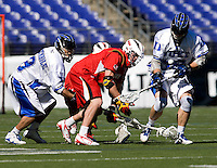 Sam Payton (32) of Duke fights for the ball with Dean Hart (16) of Maryland during the Face-Off Classic in at M&T Stadium in Baltimore, MD