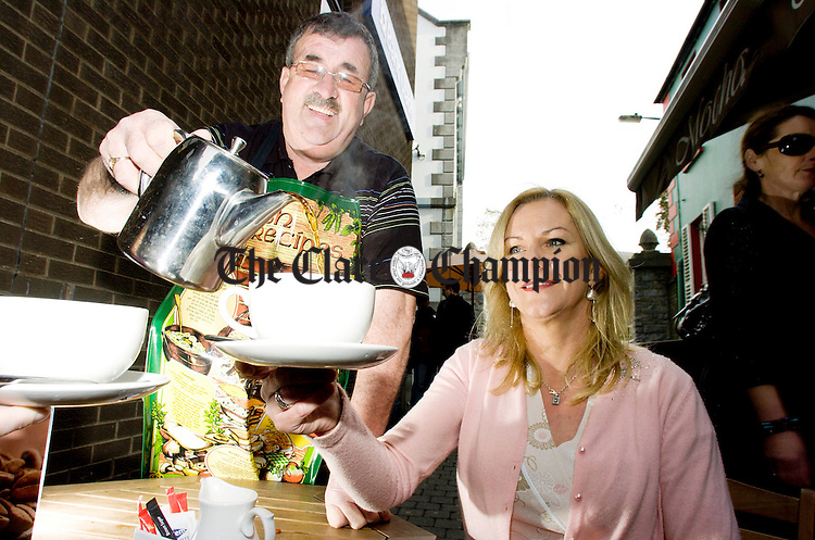 Bernard Hanrahan pours a cup of tea for Catherine Earley,IWA.Pic Arthur Ellis.