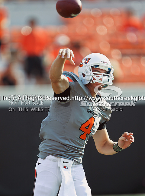 Oklahoma State Cowboys quarterback J.W. Walsh (4) in action during the game between the Louisiana-Lafayette Ragin Cajuns and the Oklahoma State Cowboys at the Boone Pickens Stadium in Stillwater, OK. Oklahoma State defeats Louisiana-Lafayette 61 to 34.