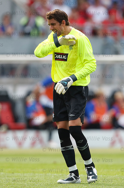 Neil Alexander bites his gloves after pulling off a save in the first half