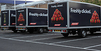Tesco delivery lorries outside a supermarket in Cardiff, UK. Tesco is the UK's largest super-market and the second-largest retailer in the world measured by profits (after Wal-Mart) and is making more money online.    30-Sept-2013.